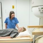 MRI Technologist talking to patient