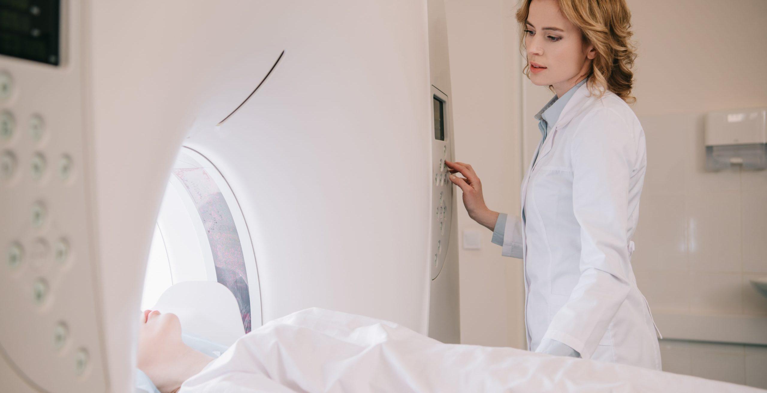 radiologist scanning patient in ct scanner
